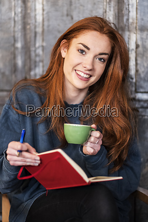 smiling young woman with long red