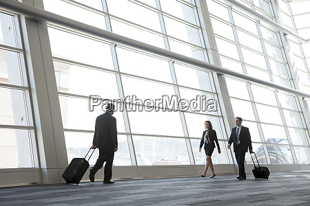 three business people walking next to