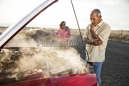 an hispanic senior couple pulled over
