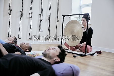 woman using a gong during a