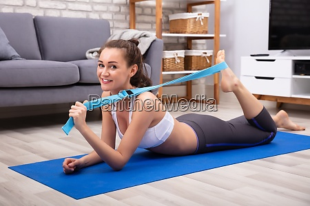 happy young woman doing workout with