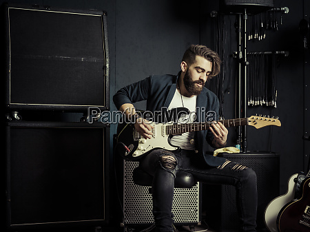 guitarist playing in a music studio