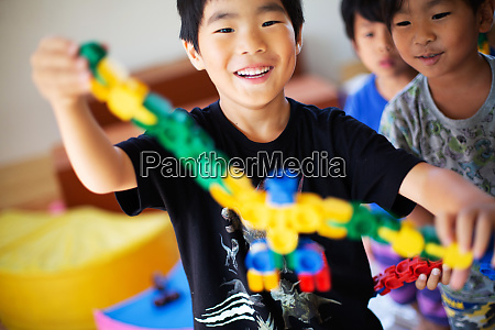 close up of smiling boy holding