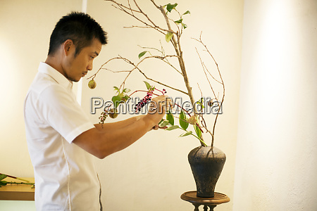 japanese man standing in flower gallery