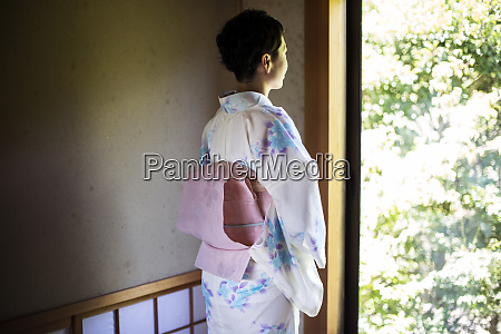 rear view of japanese woman standing