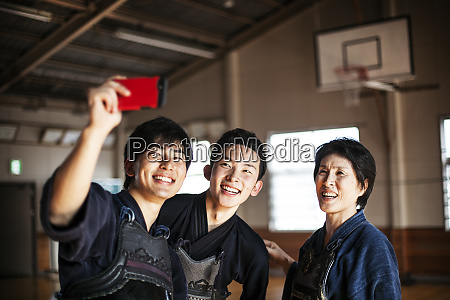 smiling female and two male japanese