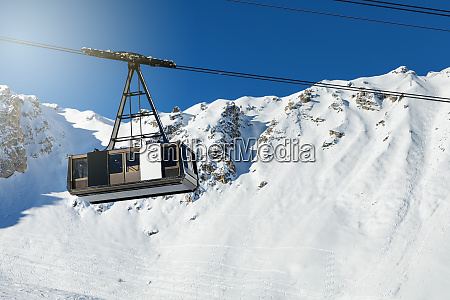 big cable car on snowy winter