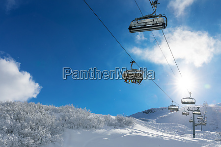 skiers in a ski lift in