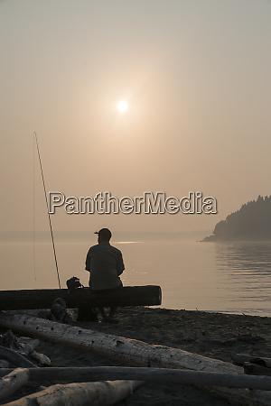 a fly fisherman taking a break