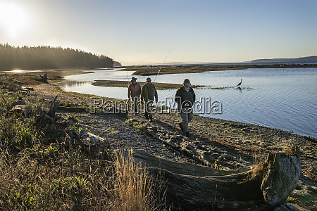 two fly fisherman and a guide