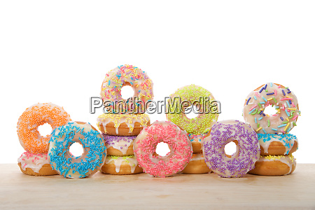 many colorful frosted cake donuts with