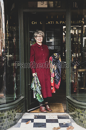 smiling senior woman wearing glasses and