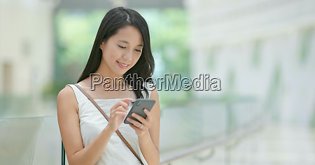woman use of smart phone inside
