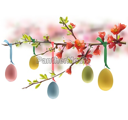 easter eggs hanging on flowering branch