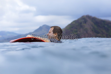 side view of man with surfboard