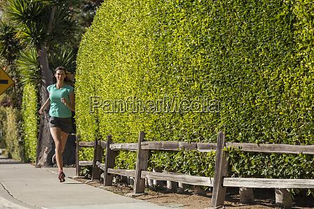 adult woman running on street san