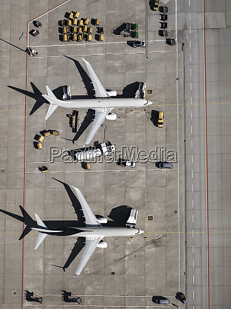 aerial view commercial airplanes being serviced