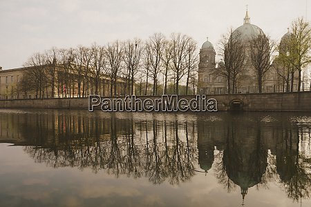 berlin cathedral along tranquil spree river