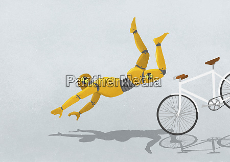 crash test dummy flying over bicycle