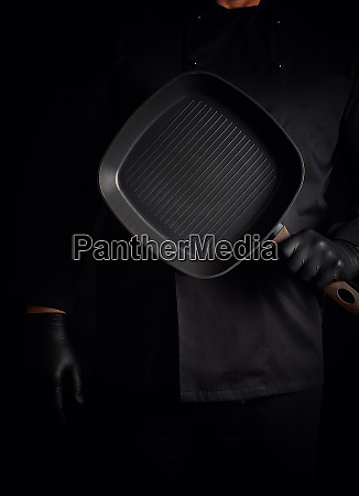 chef in black uniform and black