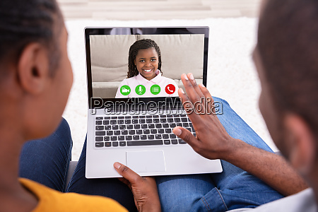 couple video conferencing with their daughter