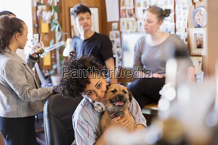 portrait creative female designer with dog