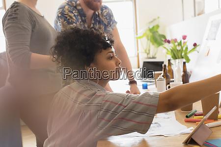 focused creative female designer working in