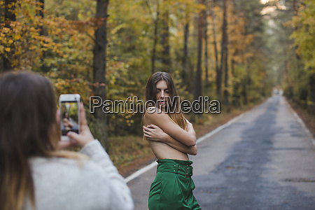 woman taking cell phone picture of