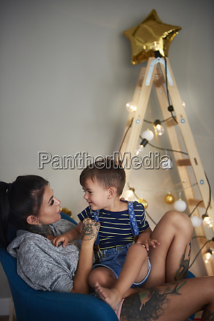 happy boy with his mother at