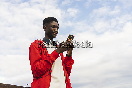 young man with headphones reding text