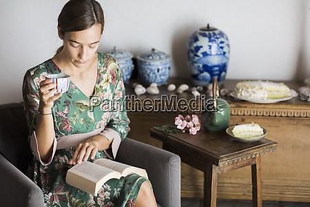 young woman drinking cup of tea