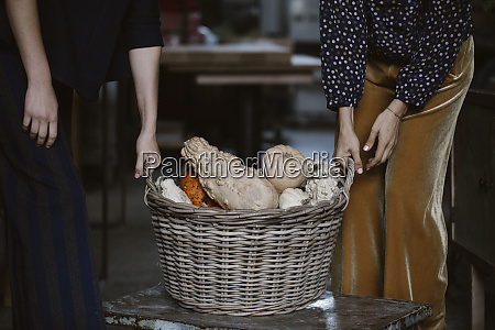 two women with wickerbasket of decorative