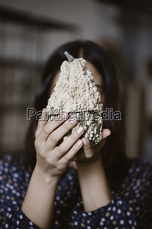 womans hands holding sliced white decorative