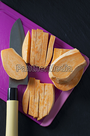sliced and sweet potato on chopping