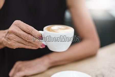 close up of senior woman holding