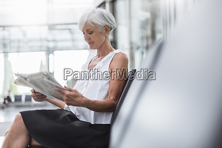 senior woman sitting in waiting area