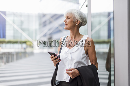 senior woman with cell phone in