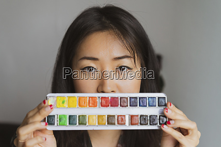 portrait of woman with paint box