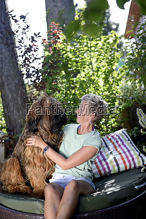 smiling woman with her dog in