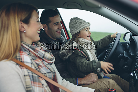 happy family in car with little