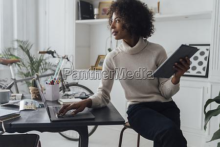 mid adult freelancer sitting at her