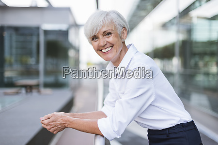 portrait of happy senior woman leaning