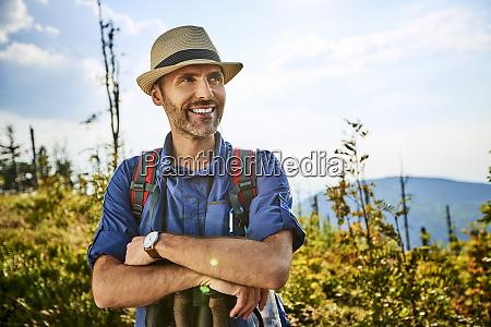 portrait of smiling hiker enjoying beautiful