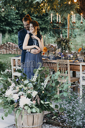happy bride and groom embracing at