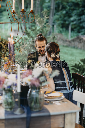 happy bride and groom sitting at