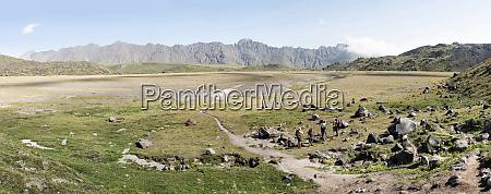 russia caucasus mountaineers hiking in upper