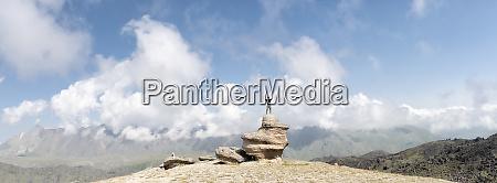 russia caucasus mountaineer standing on rock