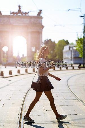 italy milan young woman walking in
