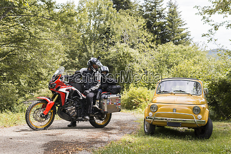 father and son on a motorbike