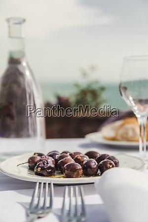 italy atrani black olives on plate